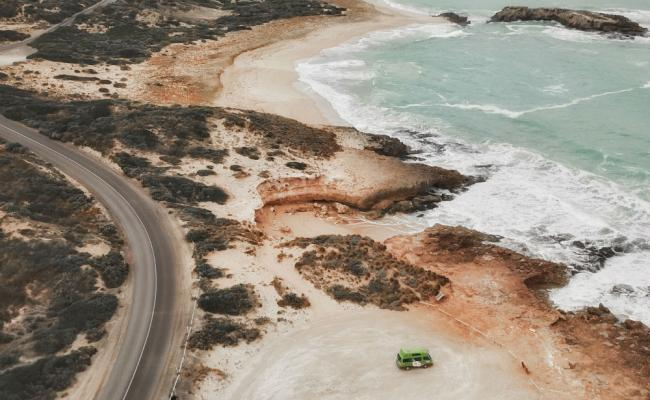 aerial view of jucy camper on south australia coastline