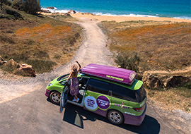 girl travelling from cairns to brisbane in a jucy campervan