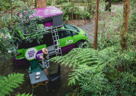 jucy campervan parked in forest between brisbane and sydney