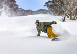 Snowboarder on slopes at Mount Hotham