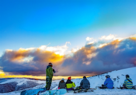 snowboarders resting on slopes at Mount Hotham