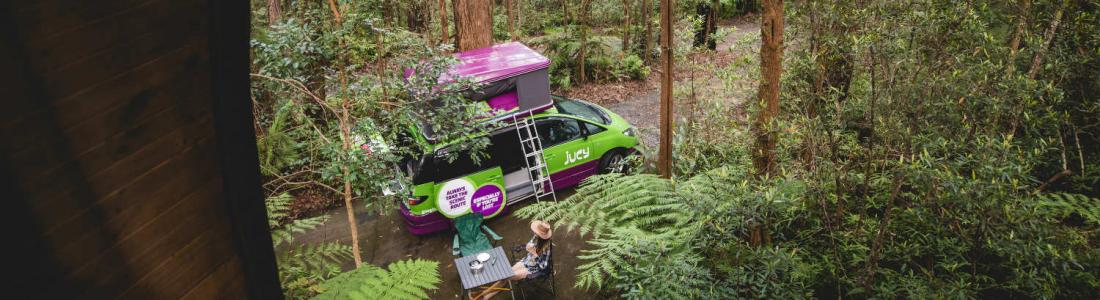 jucy campervan with campers parked in springbrook national park